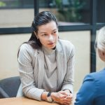 Employer discussing with employee